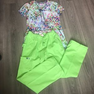 Koi scrub set. NWOT Multi color top w/ green pants